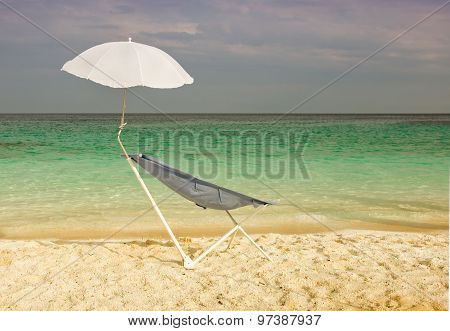 Sunbed And Parasol On The Beach