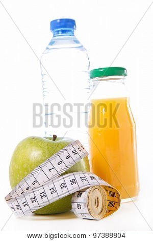healthy apple,measuring tape with milk and orange juice