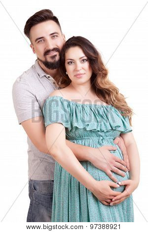 Happy Pregnant Woman With Her Husband Over White Background