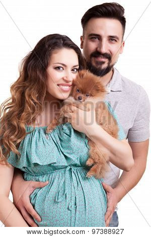 Happy Couple With Pregnant Woman And Puppy Isolated Over White Background