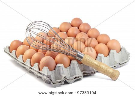 Whisk and Fresh Chicken Egg.