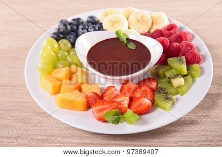 fruits and chocolate sauce