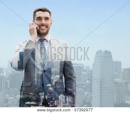 business, technology, communication and people concept - smiling businessman with smartphone talking over city background
