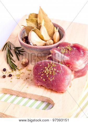 Row Tenderloin With Herbs On Cutting Board. - Steak Preparing And Ingredients.