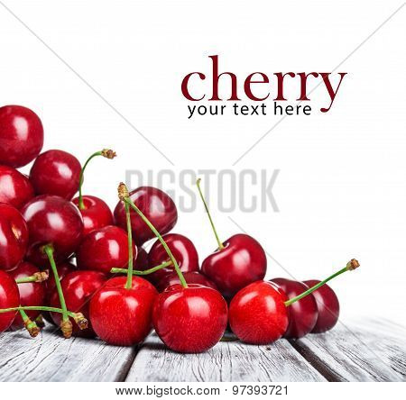 Ripe Cherries On A Wooden Table. Your Text Can Be Here.