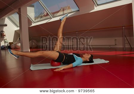 a young fit woman in the gym doing pilates workout