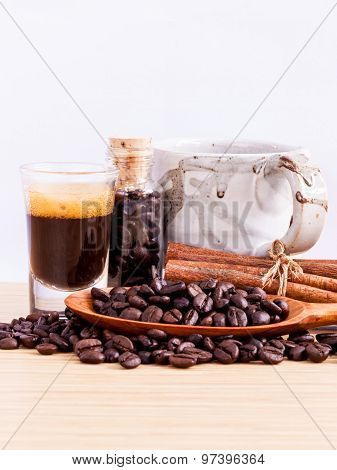 A Coffee Cup And Coffee Beans On  Wooden Panel - With Copy Space,concept For Coffee And Aroma Refres