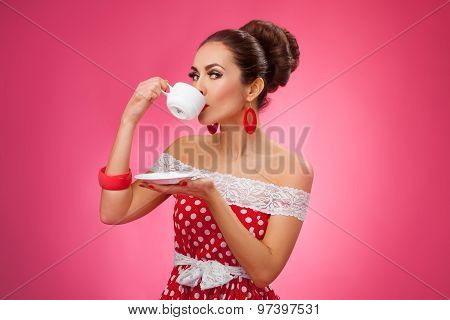 Happy Woman Holding Cup of Tea and Drinking. Pin-up retro style.
