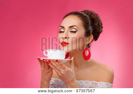 Happy Woman Holding and Smells a Cup of Tea. Pin-up retro style.