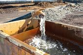 picture of groundwater  - pumping away fresh groundwater in a basin - JPG