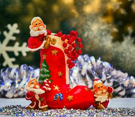 picture of gnome  - boots for gifts souvenirs Christmas toys gnome on the background of the winter window - JPG