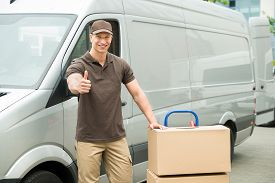 pic of moving van  - Young Delivery Man In Front Van With Cardboard Boxes Showing Thumbs Up Sign - JPG