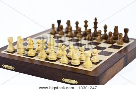 setup wooden traveler chess board with selective focus