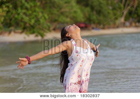 Woman Breathing On Beach
