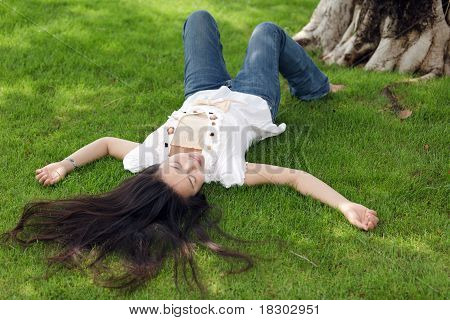 Asian Woman On Grass