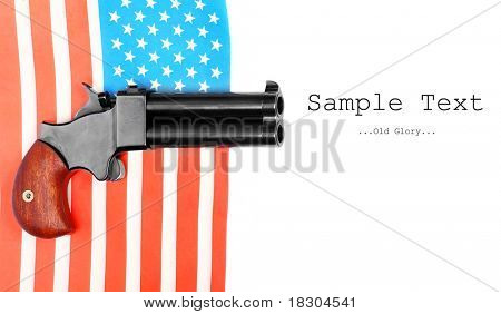 Double derringer pistol on a american flag. With easy removable text.