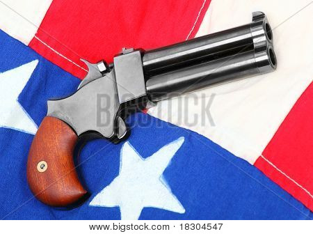 Double derringer pistol on a american flag.