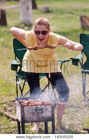Woman Grilling Shish Kebab