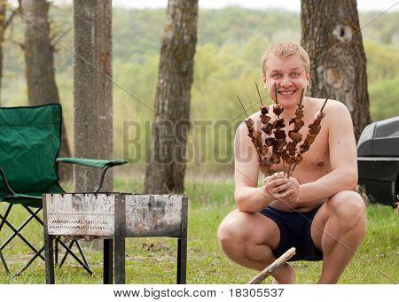 Man Grilling Shish Kebab