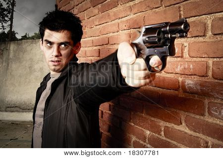 Man With Gun In An Alley
