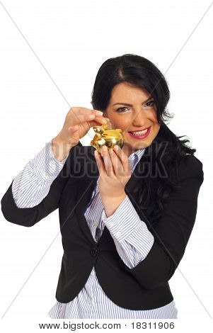 Happy Woman Put Coin In Piggy Bank