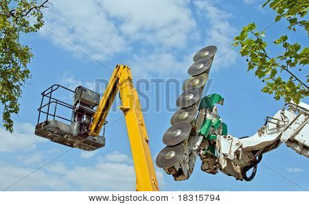 chainsaw and cherry-picker