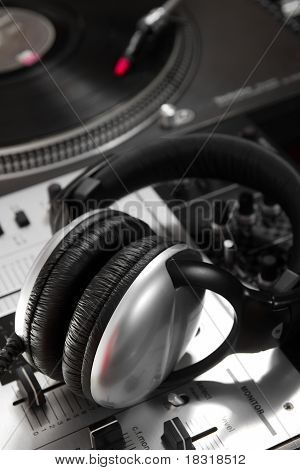 Dynamic Headphones Laying On Mixing Controller