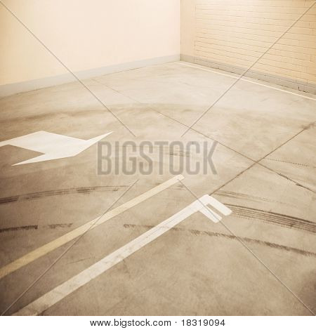 Empty parking lot floor and wall. Composition can be used as background.