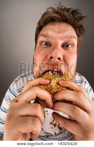 Man Chewing Hamburger