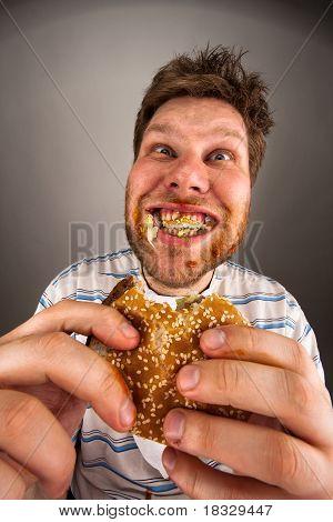 Man Chewing Hamburger