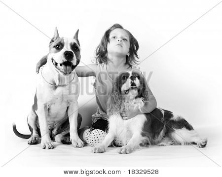 little girl 5 years old and two dogs