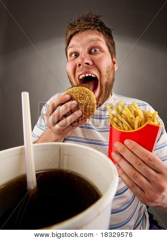 Expressive Man Eating Fast Food