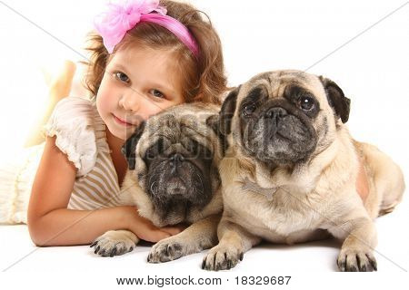 little girl 5 years old and dogs isolated on a white background