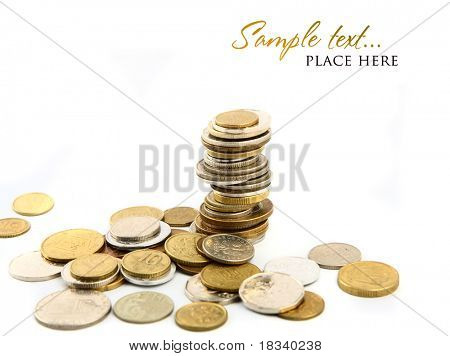 Heap of coins isolated on white background (shallow DOF)