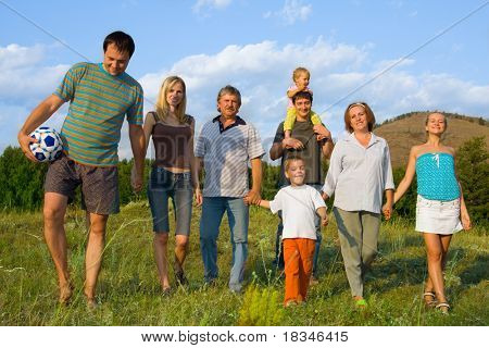 Happy big family have a rest in park