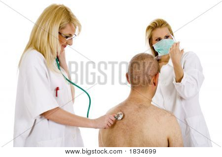 Medical Team With Nurse Holding Syringe Getting Ready For An Injection
