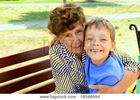 Happiness grandmother and grandson in the park. Series
