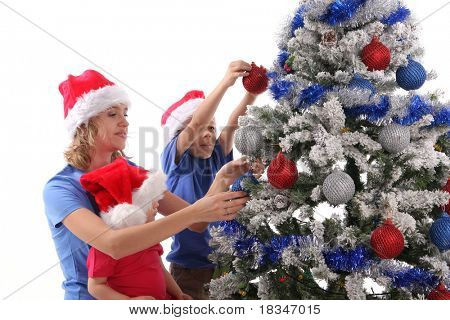 Happy mother and children over christmas tree. Series