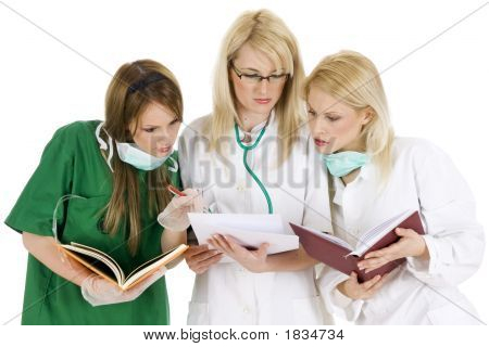 Medical Team - Female Nurses Stand With Clipboard And Stethoscope