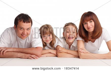 Happy family with two children isolated on white