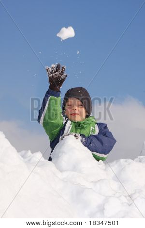 Boy a throwing snowball