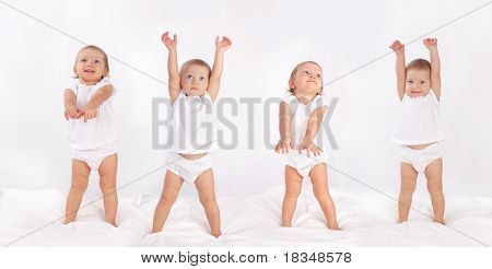 Beautiful baby dancing on bed