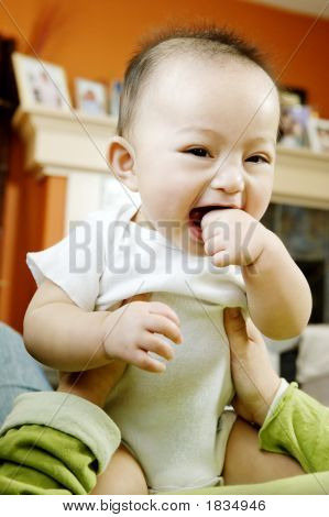 Baby Boy Held Aloft, Laughing