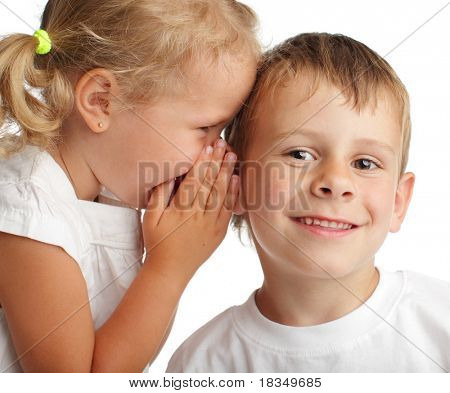 Girl whispers a secret to the boy