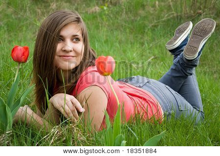 Young Girl And Tulips