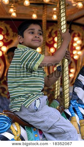 An handsome indian kid having fun at a local carnival