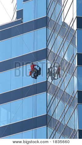 Window Washer On Blue Glass