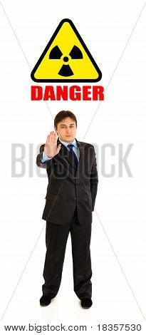 concept-radiation hazard! Full length portrait of confident businessman showing stop gesture