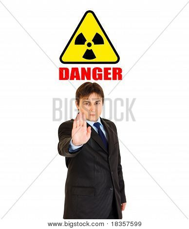 Concept-radiation hazard! Confident modern businessman showing stop gesture isolated on white