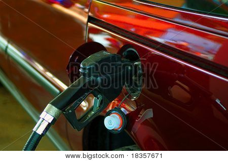 Filling up expensive gas at fuel pump